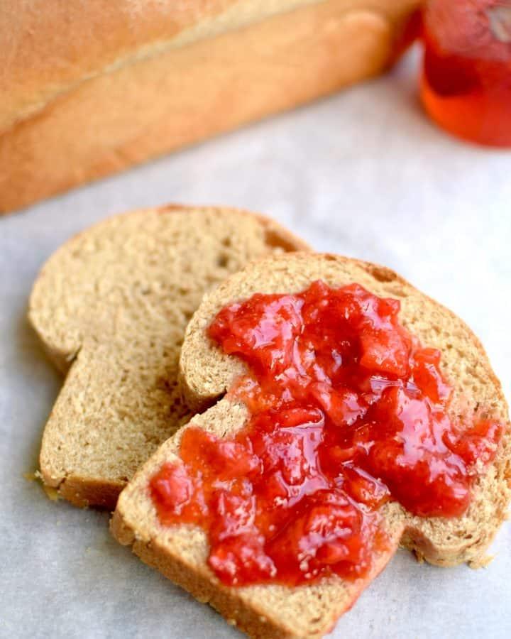 A close up shot of homemade jam and homemade bread. theincrediblebulks.com