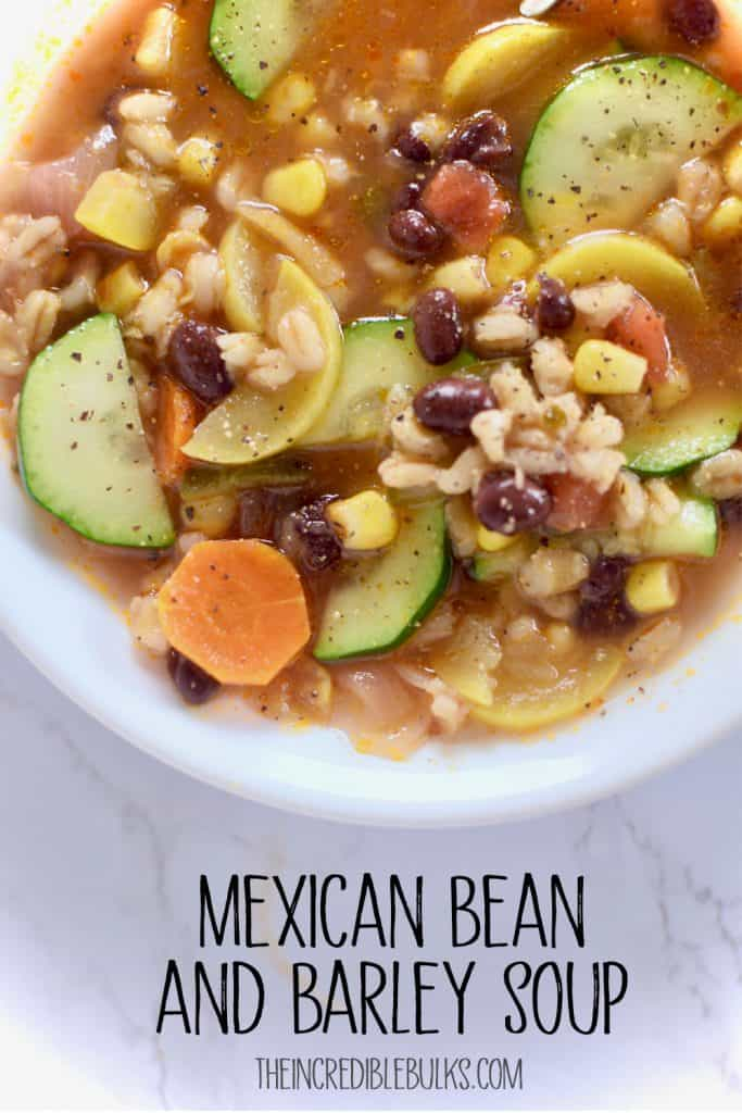 A very close up view of Mexican Bean and Barley Soup.  Black beans, yellow and green zucchini, corn and carrots.  Don't forget the barley.  theincrediblebulks.com