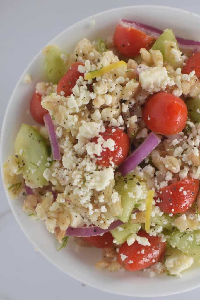 cooked barley grains in a greek salad. theincrediblebulks.com