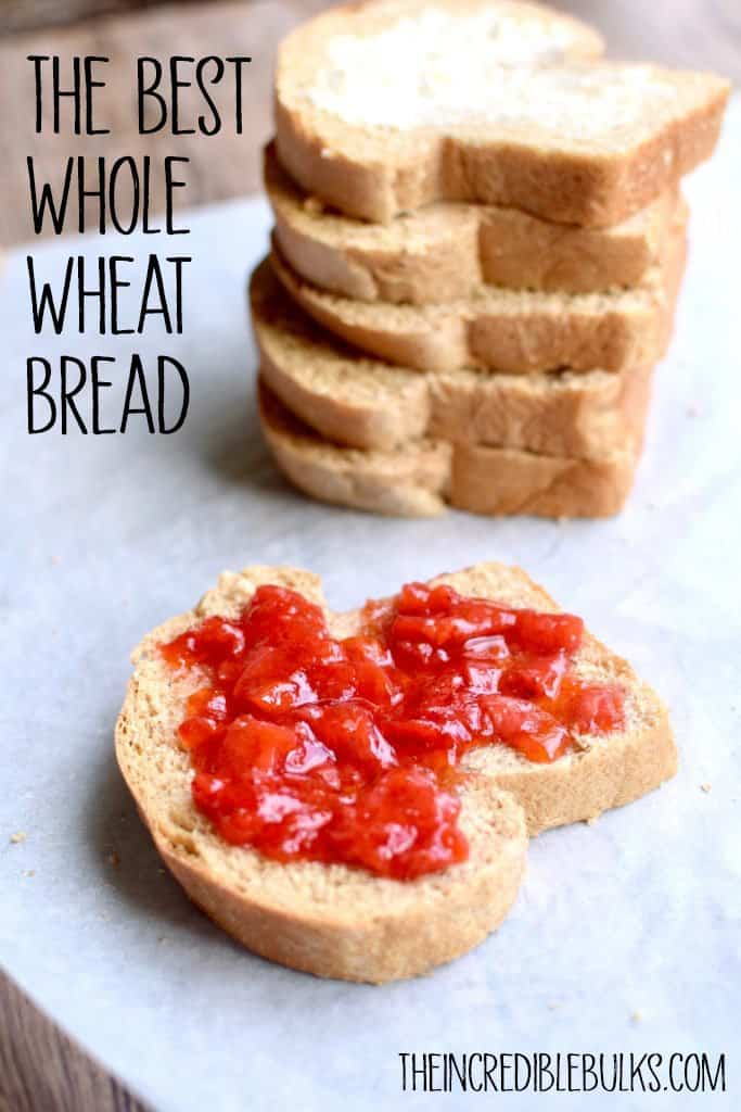 "A slice of whole wheat bread with jam is shown with a stack of bread slices behind. The words, ""The Best Whole Wheat Bread"" are shown.  TheIncredibleBulks.com"
