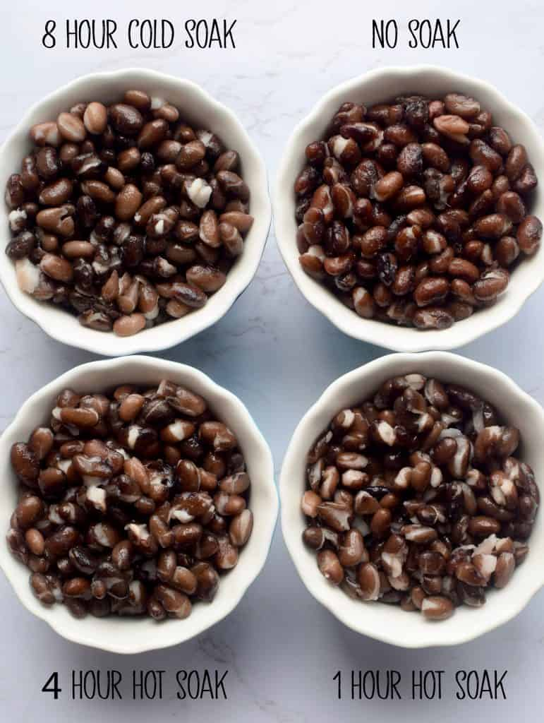 """4 small bowls are filled with cooked black beans.  They are labeled """"8 hour soak"""" """"no soak"""" """"4 hour hot soak"""" and """"1 hour hot soak"""" showing the result of different dry bean soaking methods."""