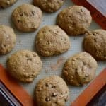 a cookie sheet filled with 12 whole wheat applesauce cookies.