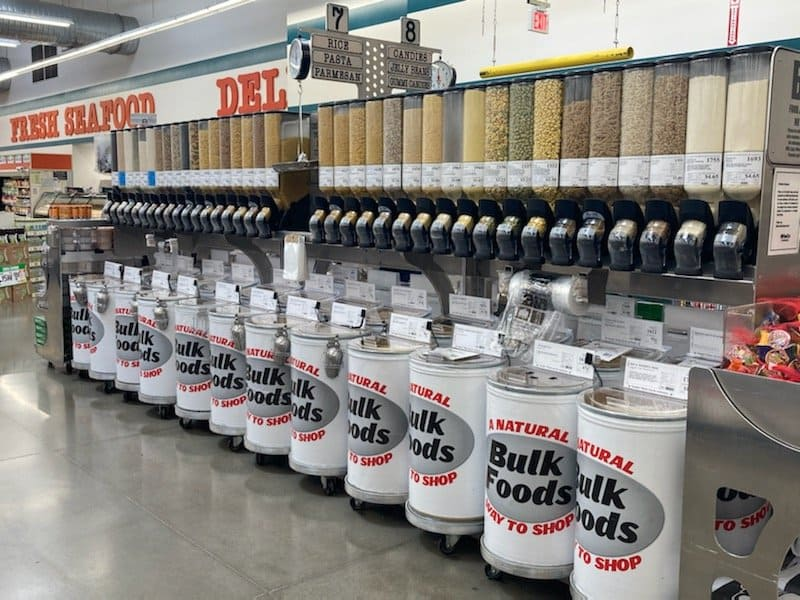 a bulk bin section of the grocery store is shown.