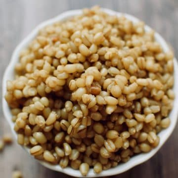 a close up view of a bowl of wheat berries.